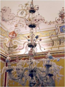 Delicate Murano glass-chandeliers light the frescoed rooms