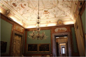 The First Reading Room (photo on the left) serves as waiting rooms of the Palatine Library. Queen Maria Carolina commissioned the library. Her husband, King Ferdinand IV, prefers hunting to reading.