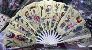 Palmette fan from 1680. The elements of the leaf are made of silk fixed on cardboards and are painted with gold and silver.
