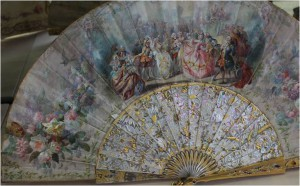 Pretty Pretender: This fan is not from the baroque era but from 1860. It is painted with a ball scene at the court of Louis XV.