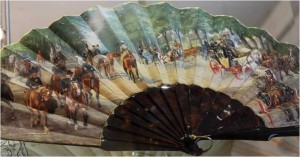 Fan painted with riders and carriages promenading in a park, 1880.